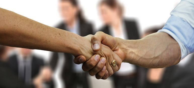 A handshake between two commercial movers Fort Lauderdale.