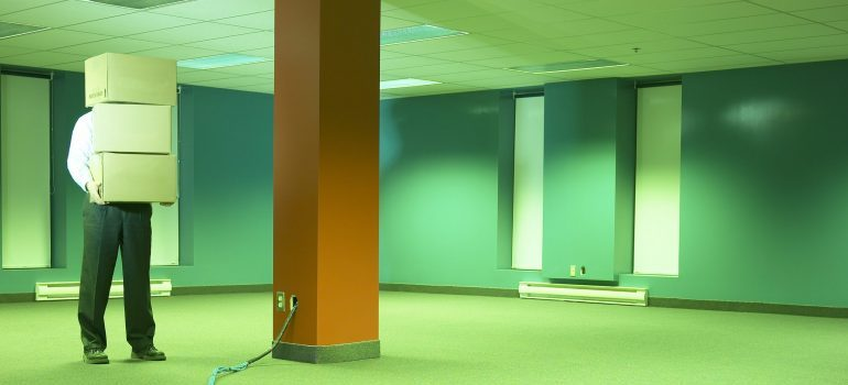 man standing in an empty office