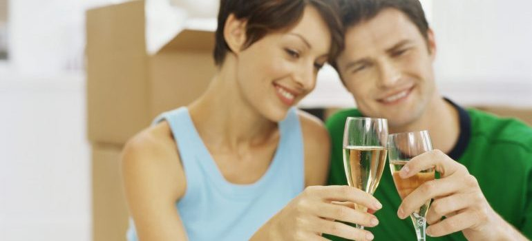close-up of a young couple making a toast