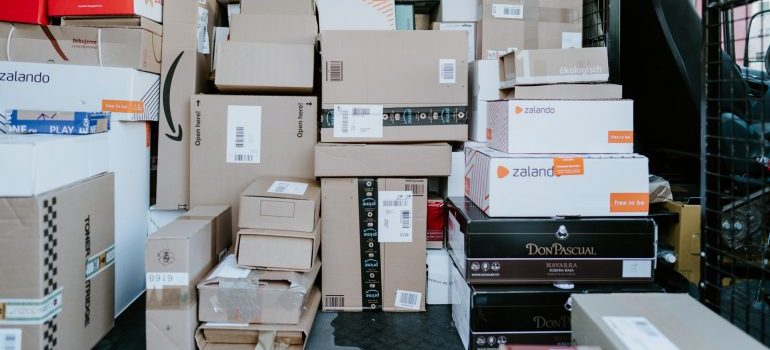 A room full of cardboard boxes - declutter your home before moving to Hallandale Beach