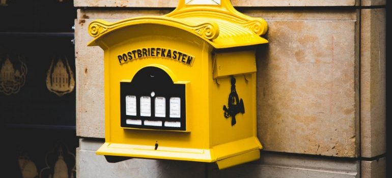 A yellow floating mailbox - change your address before moving long distance