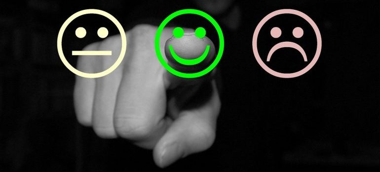 a guy pointing at a smiley in the middle