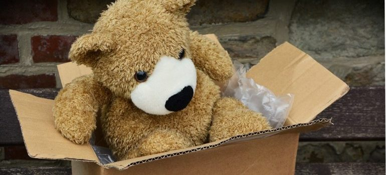 When you pack your children's room, pack a teddybear in a box