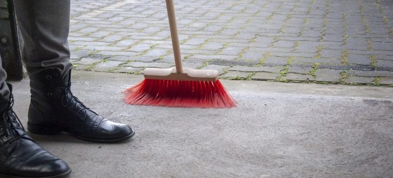 Man sweeping the floor.