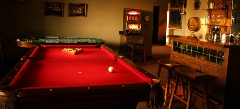 A pool table in a game room.