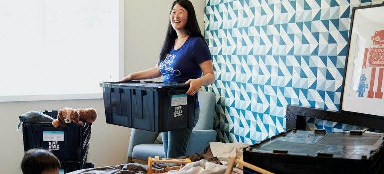 A woman packing for relocation