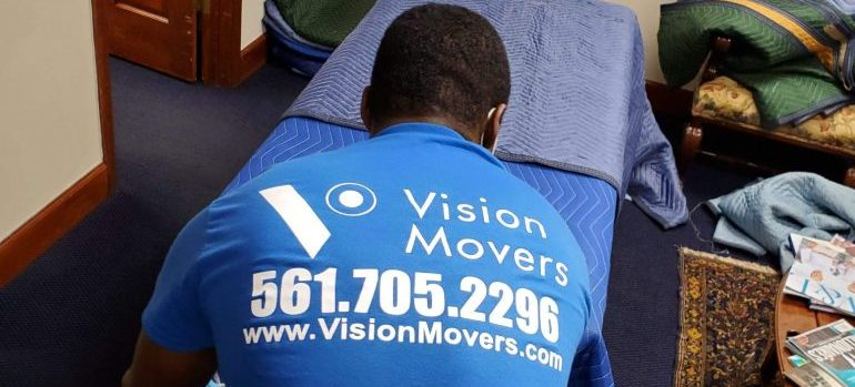 a member of local movers Florida packing an item