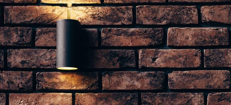 lamp attached to a brick wall