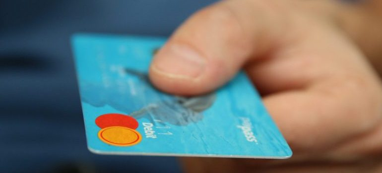person holding master card