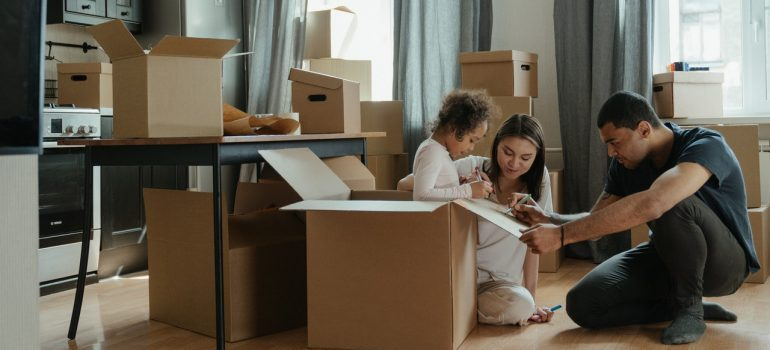 Family packing by using moving boxes Fort Lauderdale