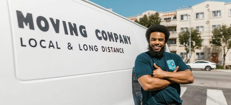 A professional mover next to a van