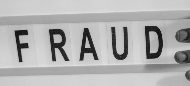 """a sign that says """"fraud"""""""