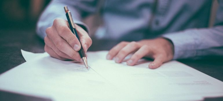 Man signing insurance papers