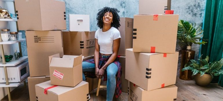 Girl surrounded by moving boxes